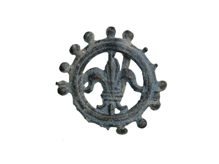 Pilgrim badge Pilgrim badge of the Virgin Mary, possibly from the shrine of Our Lady of Walsingham in Norfolk. This badge is in the form of a fleur-de-lys surrounded by a circular frame. The fleur-de-lys was one of the symbols of the Virgin Mary. The edge of the frame is decorated with ball crockets. Crockets on frames are common on Walsingham badges of the mid-15th century so this badge may be a Walsingham pilgrim souvenir.  Production Date: Late Medieval; 15th century