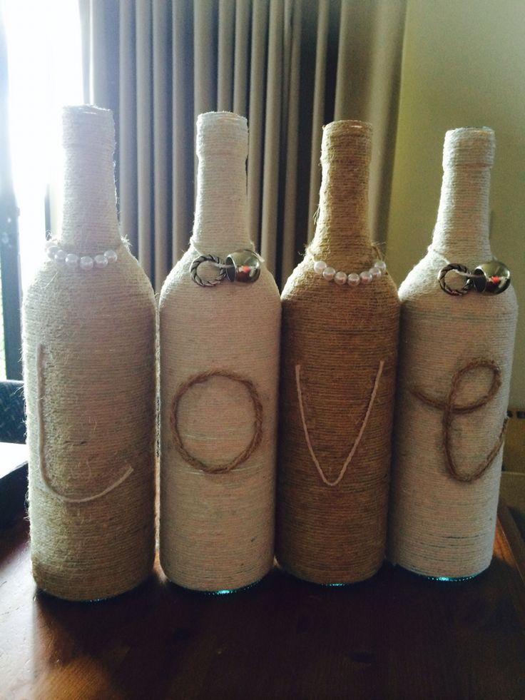 Wine bottles wrapped with twine