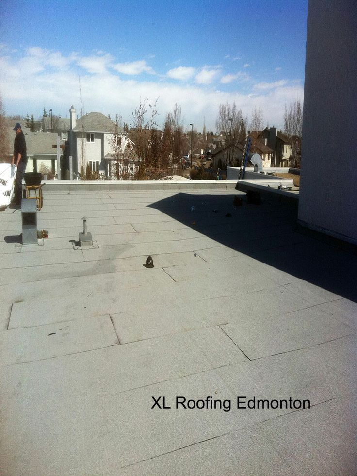 This is just a different angle of the finished 2 ply SBS roof. You can see a couple guys from the XL Roofing crew on the left once again disposing of the last of the garbage. *** Lloydminster roofing,  Edmonton roofing,  Edmonton roofing company,  Edmonton roofing contractor,  roofing companies Edmonton, roofing contractors Edmonton,  Edmonton roofing companies,  Edmonton roofing contractors,  metal roofing contractors edmonton, roof repair edmonton