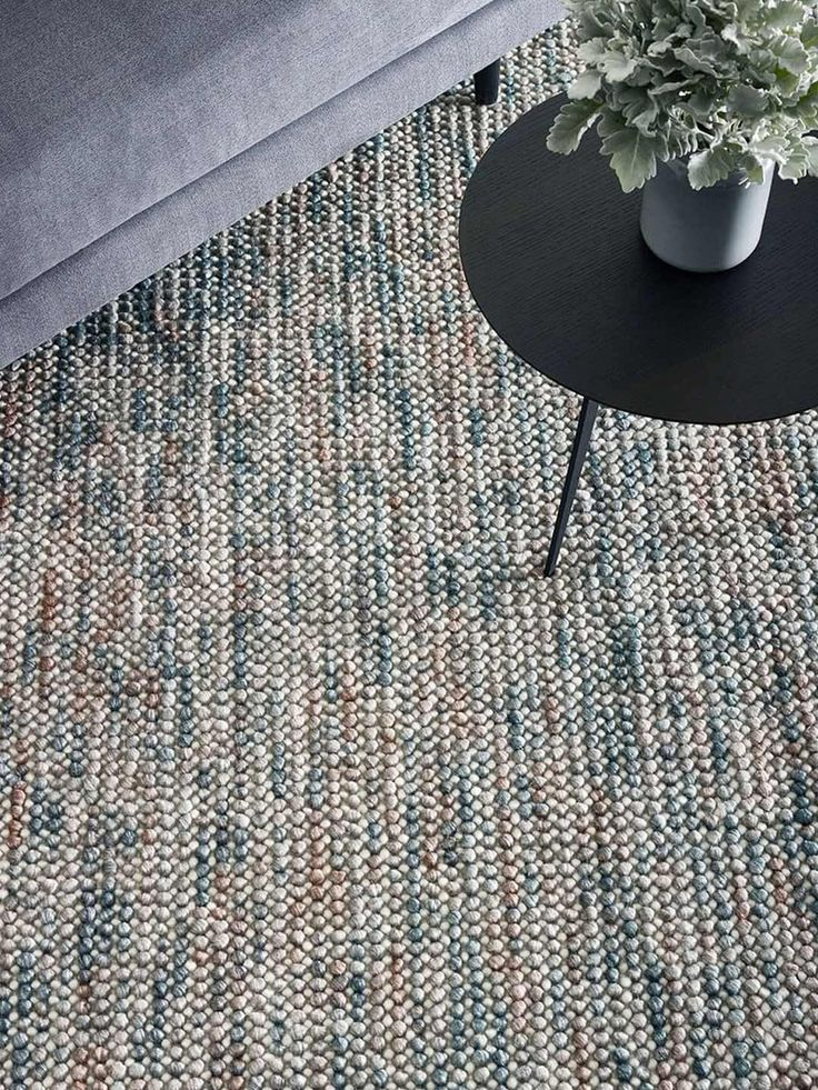 Best A Hand Woven 100 Wool Rug In A Loop Pile Textured Weave 400 x 300