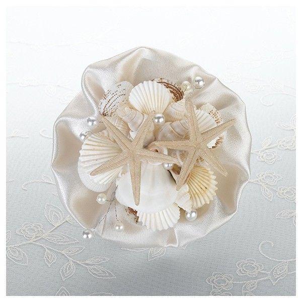 Questo meraviglioso bouquet è un alternativa originale ed elegante al classico bouquet  di fiori: realizzato con conchilie in resina ed arricchito da delle perle  Disponibili tutti gli accessori della stessa seria