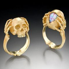 """halloweencrafts: Kim Eric Lilot Skull and Brain Rings. """"Tribute to a Genius"""" 18kt yellow gold with a carved, Australian Fire Opal brain. Go to the link to see more amazing jewelry."""