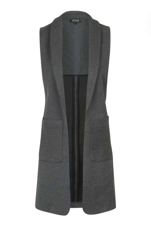 Such a cool vest, love the length, would be even better with a closure of some kind.