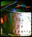 "hand stamped metal bracelet ...made with an old leather belt! ""Think happy thoughts"""