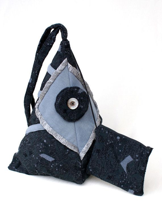 Backpack handmade with black/grey velvet fabric, decorated with gray iridescent crisp fabric and nacre button. Secure zip closure on the back. Inside lining of white cotton, an interior zippered pocket, an interior opened pocket for cell phone. Always inside, a pochette with zipper, attached to the backpack with a drawstring.