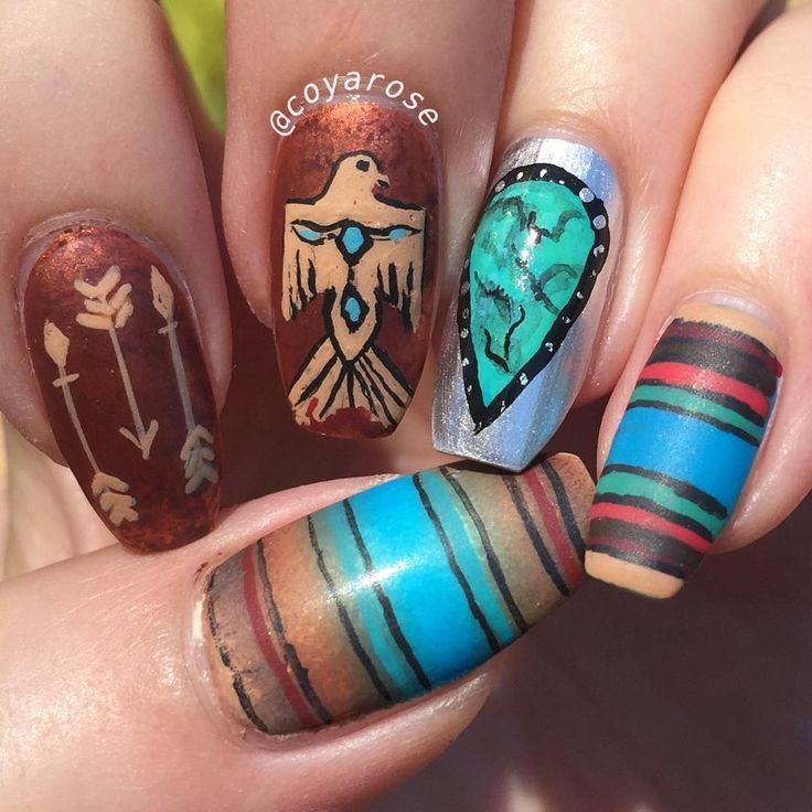 Southwestern hand painted nail art.  Serape, turquoise, thunderbird nails.