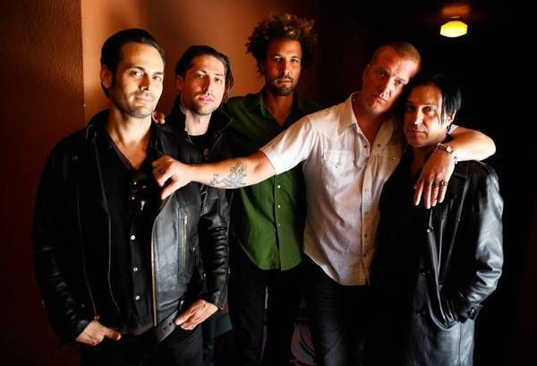 LOSANGELES-ME-May 23, 2013: The band, Queens of the Stone Age, are Dean Fertita, left, Michael Shuman, Jon Theodore, Josh Homme and Troy Van Leeuwen.