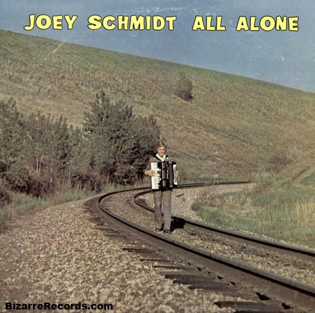 A man and his accordion on the railroad tracks - geeze! Is he hoping to get hit by a train to end his misery? Does the record come with a razor blade?!