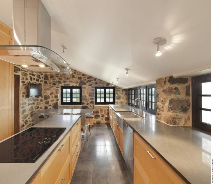 concrete house, kitchen design. stainless steal, textured walls but where is the oven!