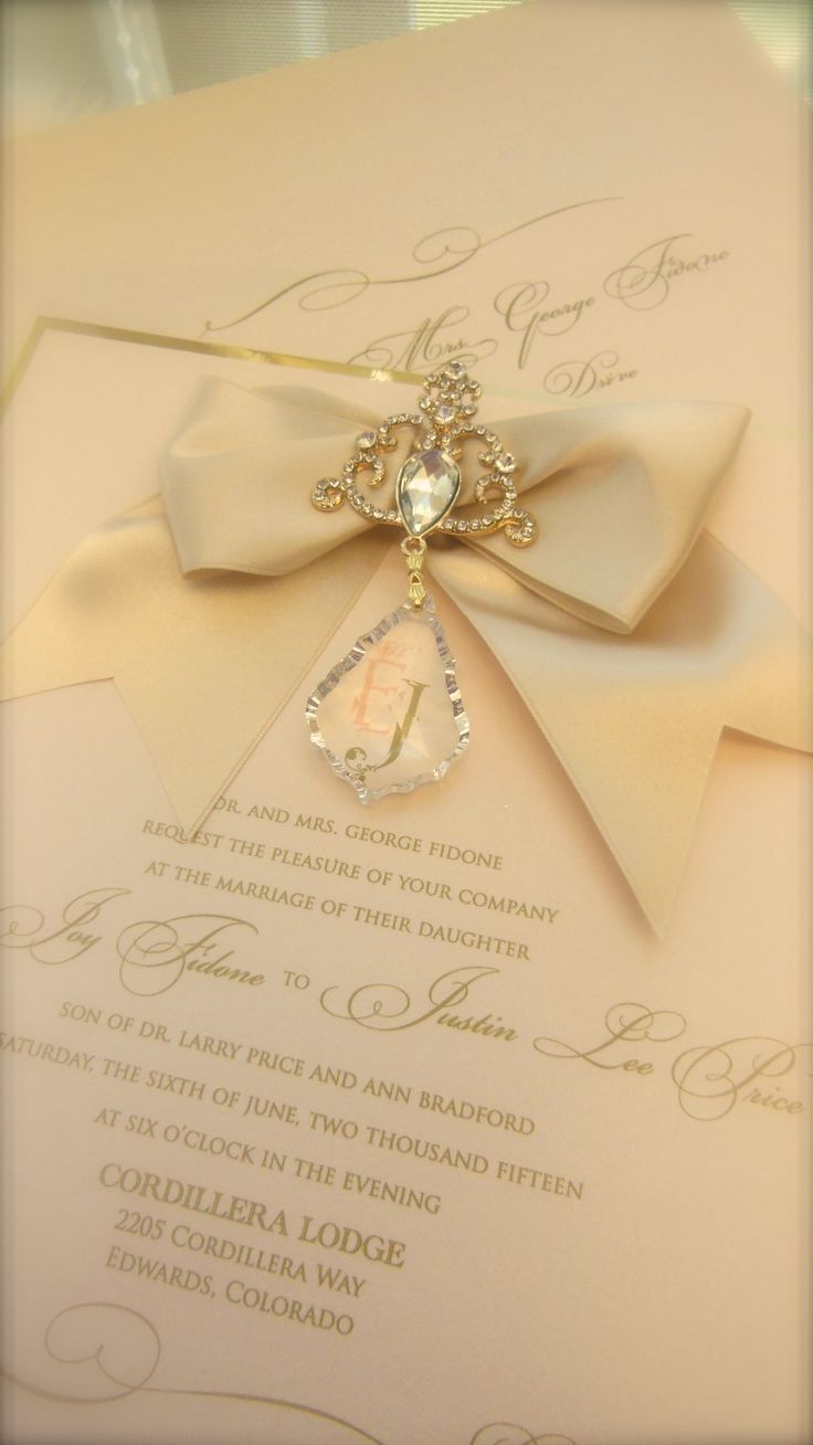 Blush and gold hanging crystal invitation with ornate embellishment brooch. xo embellishments