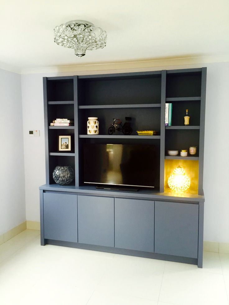 Eclectic Media Storage Unit. Useful for any room in your home as it is freestanding and can be taken with you when you move. Cupboards below store Sky or Freeview box and when magic eye fitted, TV can be operated with remote with closed doors.  Perfect.