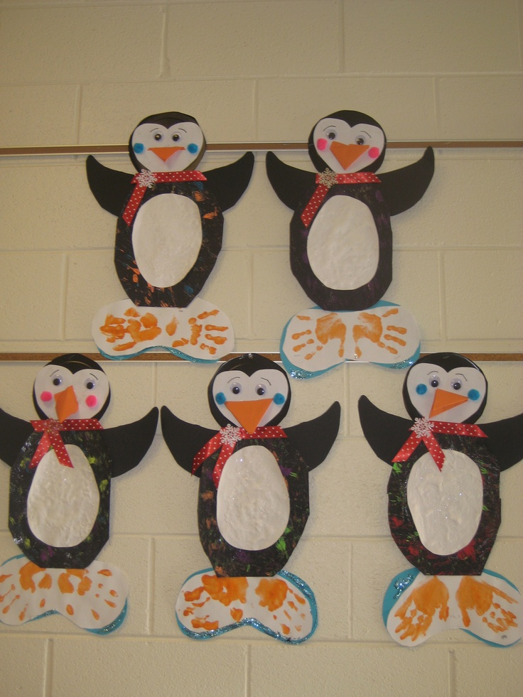 Student made penguins. The feet are handprints, the stomach is made from paint and shaving cream. The beaks are origami.