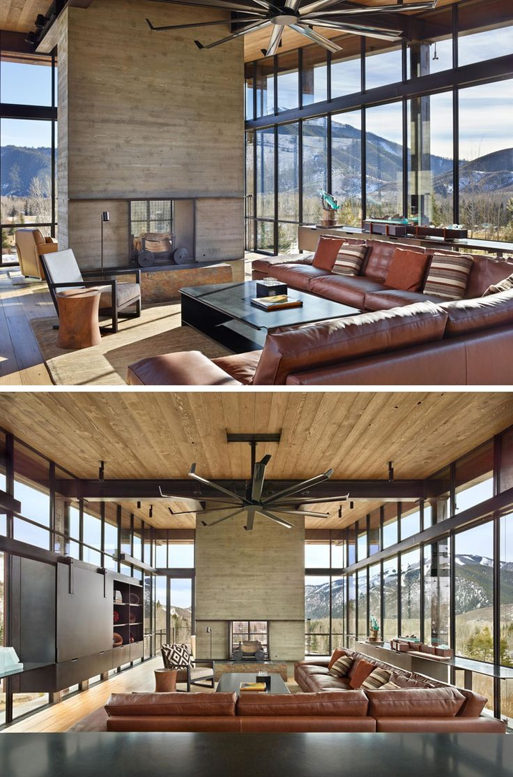 In this living room, a see-through fireplace can be enjoyed from both sides, and a large leather sofa has been paired with a curved-edge steel coffee table. Installed above the living room is a large fan with steel blades, ideal when trying to create a modern industrial space.