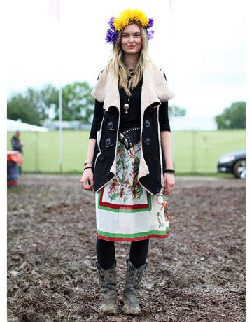 We love everything about her head-turning look: scarf print skirt, shearling vest, studded accessories, muddy cowboy boots, but it's the bright floral headpiece that won her the award for most optimistic festival style.