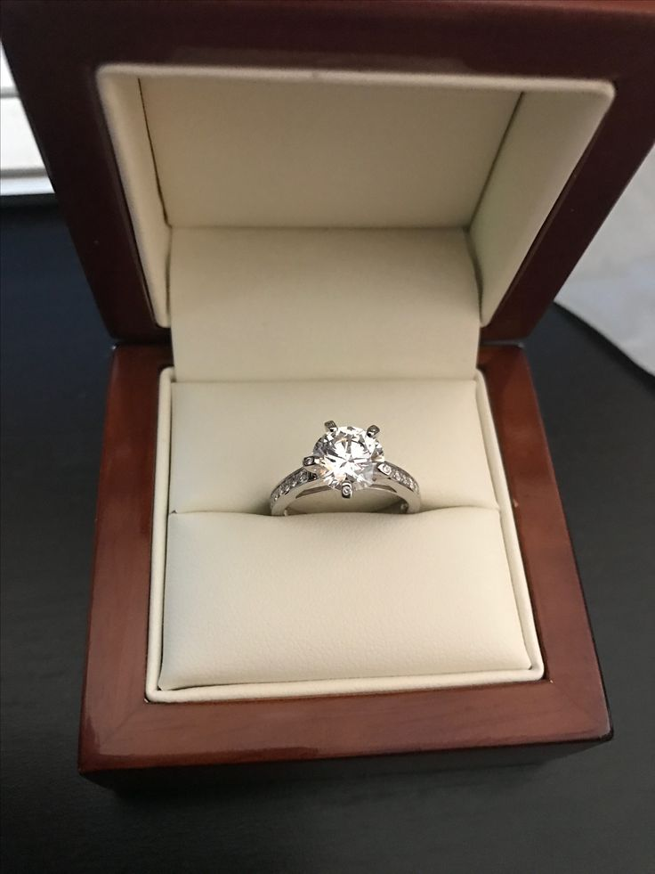 Latest design for happy customers 2.04ct D VS1 Round brilliant set into platinum band with diamonds on claws and band
