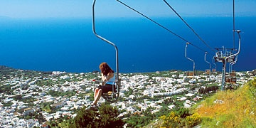 AnaCapri, Italy.  You ride these rickety chairs to the zenith of the island and experience the beautiful view from Tiberius's gardens!   We hiked down which took about 5 hours, but we also took our sweet-time to have a lovely picnic and not cut this experience short.