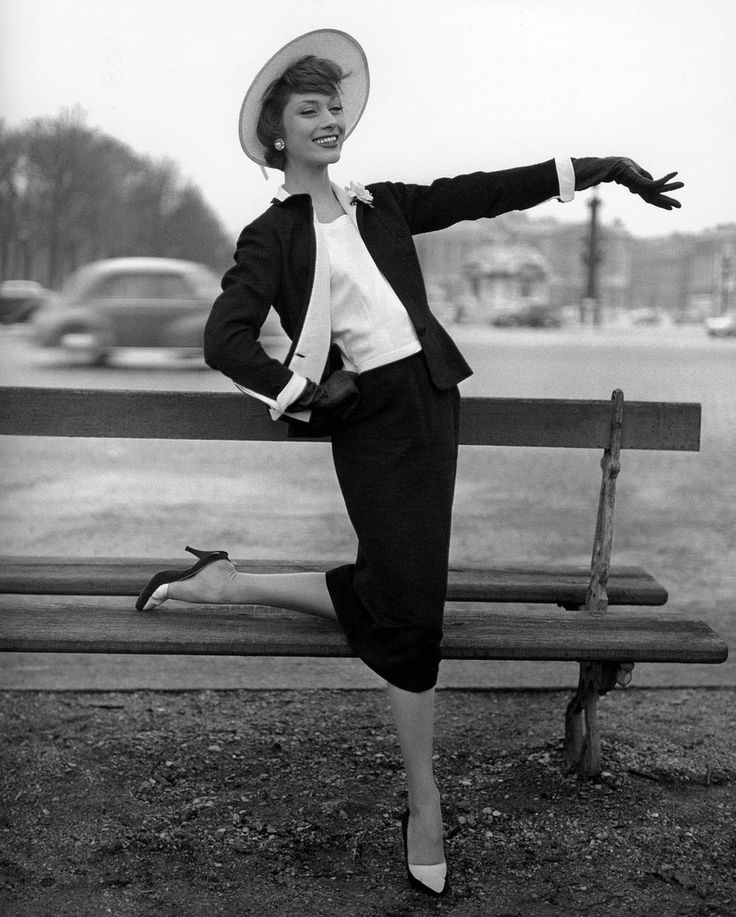Marie-Hélène Arnaud in elegant black shantung and white piqué suit by Chanel, photo by Georges Dambier, ELLE, February 11, 1957