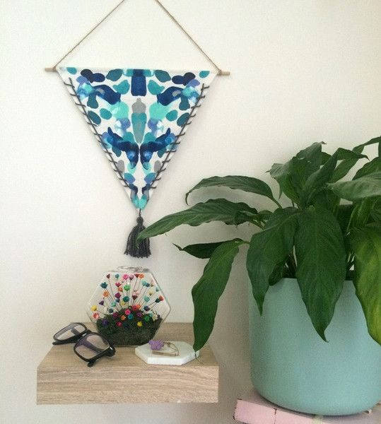 Our Hexi is multi-purpose. It can sit pretty on its own or you can hang it on a wall!