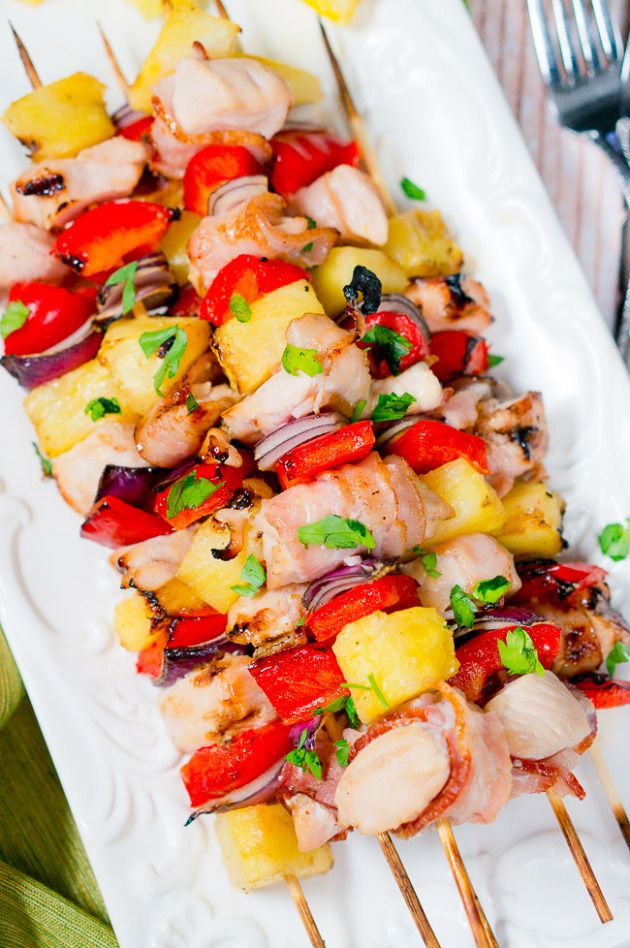 Perfect summer grilling recipe - Juicy Bacon Pineapple Chicken Kebabs. You'll be licking your fingers through the whole meal and asking for seconds!