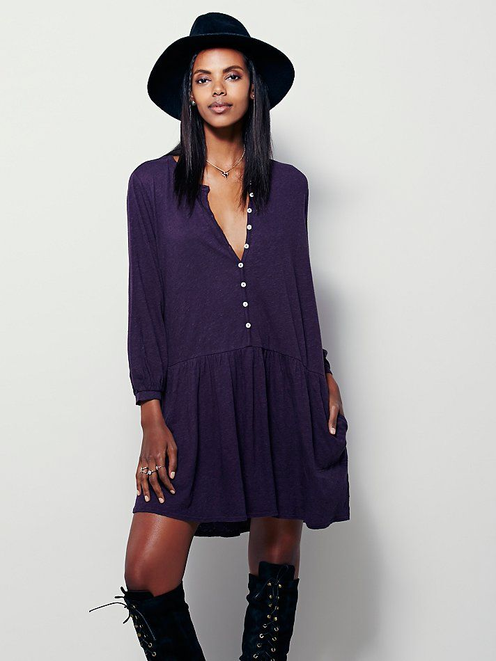Button Up Dress | Lightweight dropwaist long sleeve mini dress featuring an effortless, oversized fit.  Delicate buttondown detailing.  Hip pockets.   *FP Beach  *One of 9 exclusive, in-house labels.  *Effortless seaside styles.