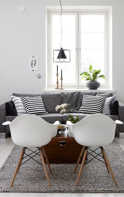 Grey and white living room via My Scandinavian Home.