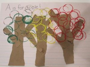 "A is for Apple.  Tear up construction paper & allow kids to paste it down.  Have kids use a paper cup, toilet paper or paper towel tube to dip into paint (red, yellow, or green).  Press upon the paper to become ""apples""."