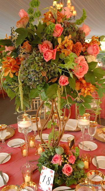 Dark green hydrangea coral roses bells of ireland