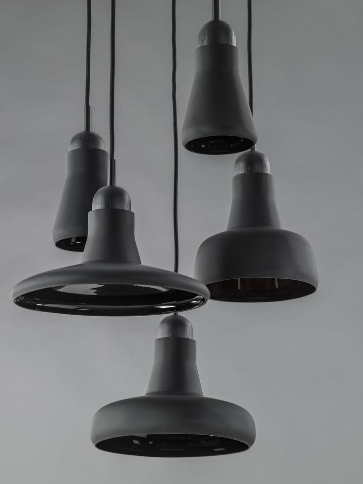 Interior - Brokis lights - Black Mat Shadows are hanging lights. The designer Lucie Koldova and Dan Yeffet.