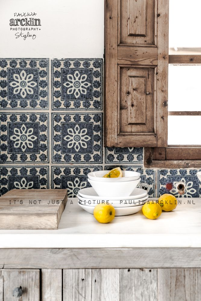 wood window with blue tile in a kitchen. rustic, bohemian styling