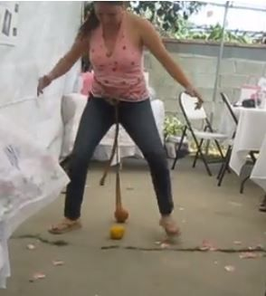 You can call 4-5 guests at a time to play this one of the naughty bridal shower games. Tie a ball with a stockings on the waist of each guest playing the game