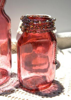 color glass jars with mod podge and food coloring.  Like this even better than the paint method...great jewel tones.