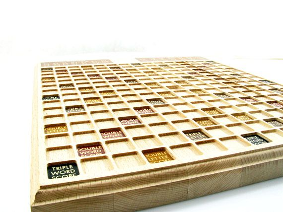 WOODEN SCRABBLE - Solid wood board  The Scrabble is one of the most popular word games. We present you home made unique game, done with the extraordinary care for every detail. Our board is hand made of selected alder wood.  The set contains: Solid wood board, 4 wooden scrabble tile racks and wooden letters. The game board measures approximately: 18,9 inch x 16,9 inch x 1,37 inch (480 mm x 430 mm x 35 mm) Tiles are : 23mm x 23mm x 6 mm  Quality: Made of High Quality Wood If you need more…