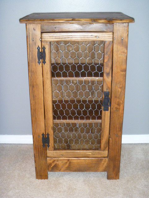 Handmade cabinet made from reclaimed pallet wood and chicken wire. Cabinet measures 32 tall x 18 1/2 wide x 14 1/2 deep. I can custom build to