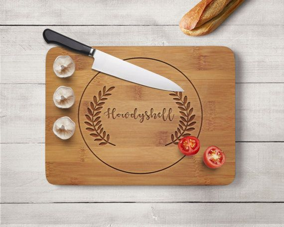 """The Beautiful Bamboo Personalized Cutting Board is perfect for cutting your favorite foods on. Our cutting boards are engraved on one side permitting the use of the other side for cutting and chopping. Product Info: • Size: 14""""x10.5"""" • Wood Material: Bamboo • Hand Wash Recommended (Not Dishwasher Safe) • Includes 1-side laser engraved design • Personalized products are non-refundable. • Laser Engraved: The design is burned into the wood, each piece of wood burns differently. The wood can…"""