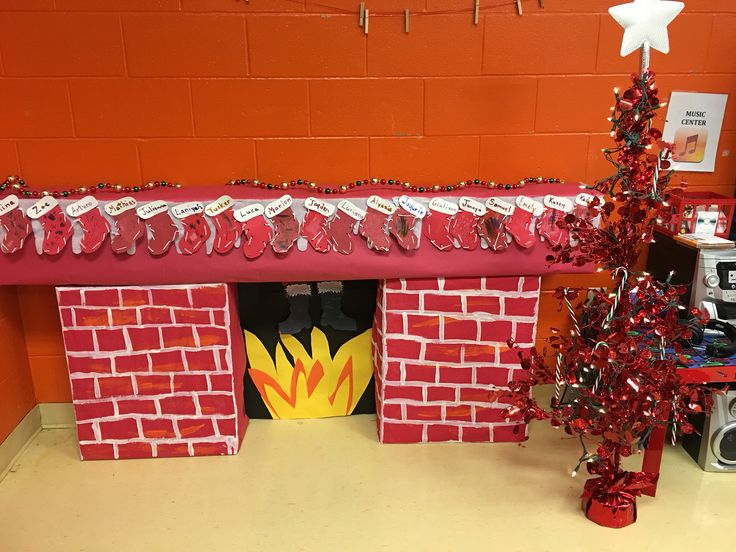 """Classroom 3D fireplace. Boxes covered with bulletin board paper. Painted with orange streaks and red tempura paint. Bricks/ white paint. Black construction paper backing and """"fire"""". Faux snow roll."""