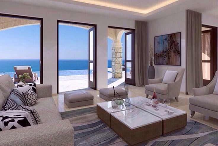 Entertaining is a dream in this sunny living room with a breath-taking sea view. | Location: Cyprus | Listing: https://www.properbuz.com/view-details?property-id=luxury-villa-aeneas-grand-villas~91649  #properbuz  #realestate #dreamhome #inspirationhome #realtor #realty #home #house #houseforsale #salehouse #realestateagents #realestateinvestor #broker #cyprus #realestatecyprus #globalrealestate  #openspace #luxuryhomes #interiordesign
