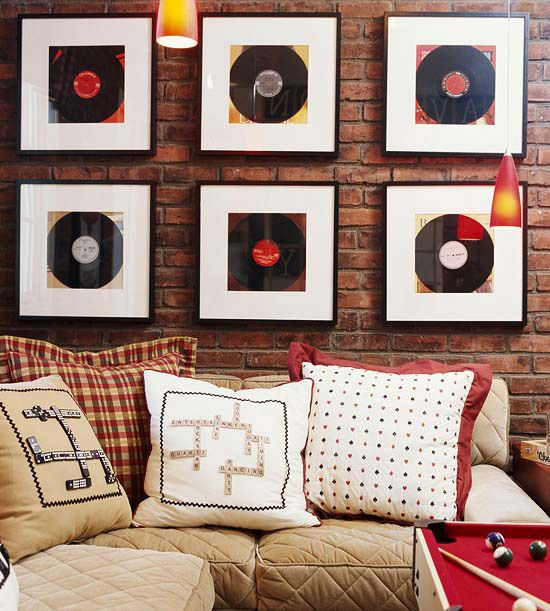 Flea Market Records  The key to creating a cozy entertainment area is setting up a simple space with lots of character: Game-piece pillows, a bold billiards table, and thrifty wall art make a winning decor combination. Classic hues of red, white, and blue inspired by vintage record wall art set the tone for this game zone.