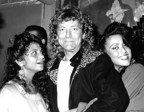 Robert Plant , the woman in front of him is his youngest son Jesse's mother., his ex-wife's younger sister