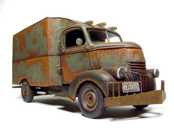 "1/25 scale ""Jeepers Creepers"" truck - ""I couldn't resist building the big, bad truck from the movie 'Jeepers Creepers,'"" says Tyler. Working with Revell's 1/25 scale 1941 Chevy pickup, he scratchbuilt much of the body with balsa wood, spray-painted flat green, and heavily weathered with Testors Model Master acrylics."