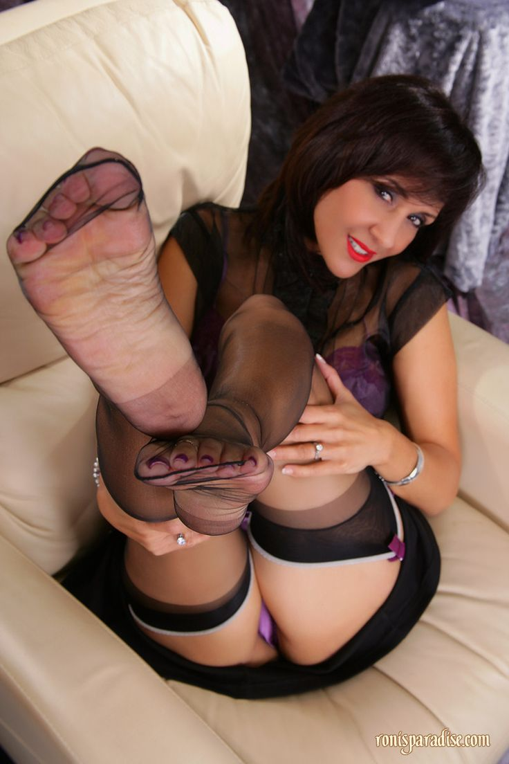 image Brunette in stockings footjob till it comes