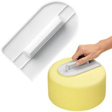 Easy-Glide Fondant Smoother    Essential tool for shaping and smoothing rolled fondant on your cake. Works great on top, edges and sides! Shapes fondant to sides of cake so that no puffed areas appear. Trim off excess with a sharp knife.  6 1/4 in. long x 3 1/4 in. wide.