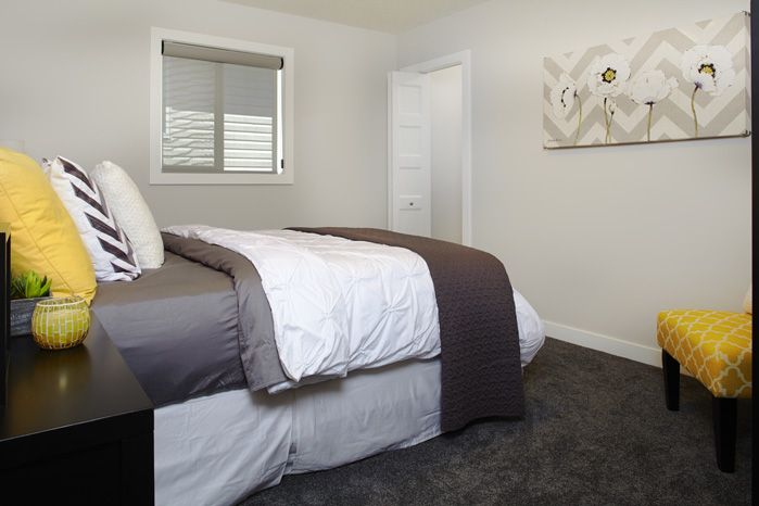 Secondary bedroom in the Tofino II showhome in Hillcrest in Airdrie by Shane Homes.