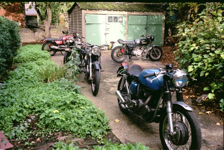 JXD dragged out of the garage circa 1991. Bikes left to right are: 1978 LeMans mk2 (seen earlier here in its original black paint, behind JXD at stage 2) 1954 BSA A10 plunger, a real hack that one. 1948 Norton model 19 and a 1978 Ducati 860 GTS
