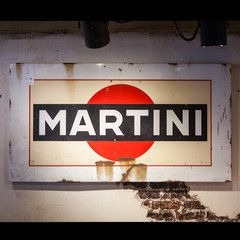 A beautiful vintage metal Martini & Rossi bar sign. Martini & Rossi is an Italian multinational alcoholic beverage company primarily associated with the Martini brand of vermouth and known for its classic advertising pieces!