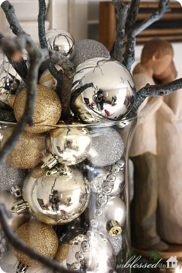 Hurrican vase full of Christmas ornaments! LOVE!!! Oh... and a few tiny sticks that we ALWAYS have in our yard :)