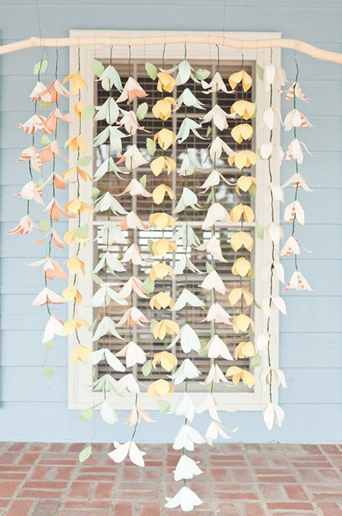 Hanging paper flower garland {Photo by 13:13 Photography}