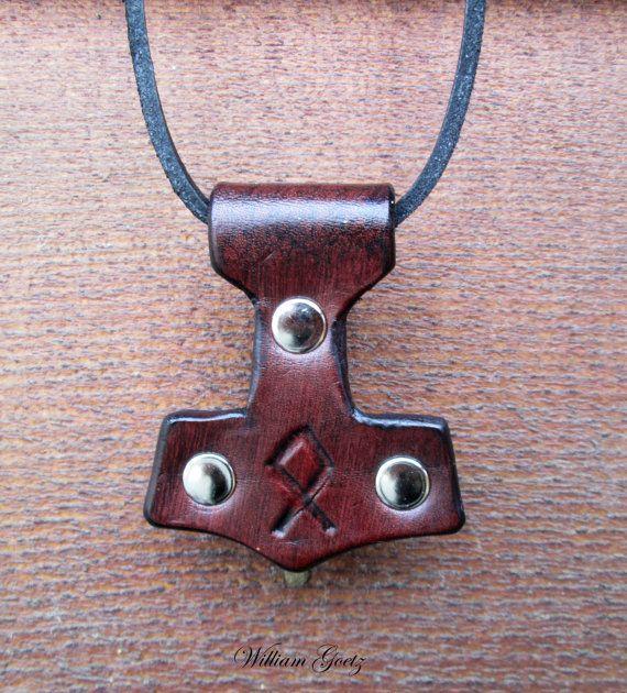 "Leather Mjölnir pendant, measuring 2.5"" tall by 2"" wide"