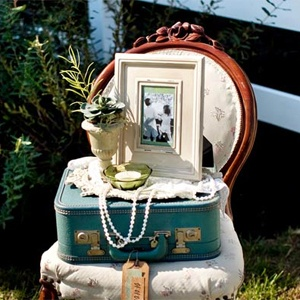 Place old family wedding photos, using classic frames in your wedding colours, or classic white, around the room. For a single hit of history, group them at the guest book table, or on a mantle in the room.