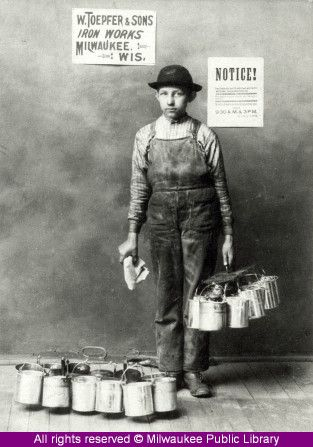 """Beer growler rusher, Milwaukee, 1892. In Milwaukee, bucket boys or """"kesseljunge"""" delivered growlers of beer from local taverns to nearby factories for workers to drink during breaks. Source: Milwaukee Public Library"""