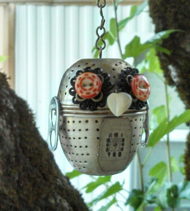 My little garden owl made with a recycled tea ball and random elements.